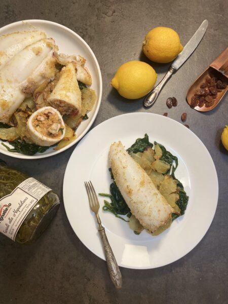 Calamari ripieni al forno su letto di patate e friarelli